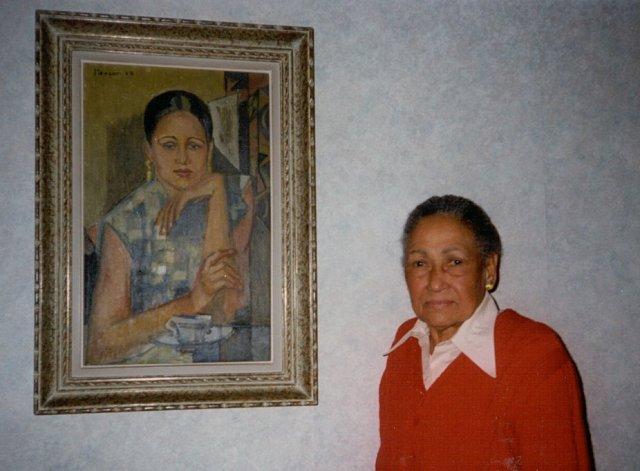 La jumelle de Mayotte Capécia. Au mur: Portrait de Mayotte Capécia (1953), de Mercan. Photo prise à Paris © 1994 Christiane Makward